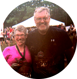 Susan and Doug at the end of a Warrior Dash run